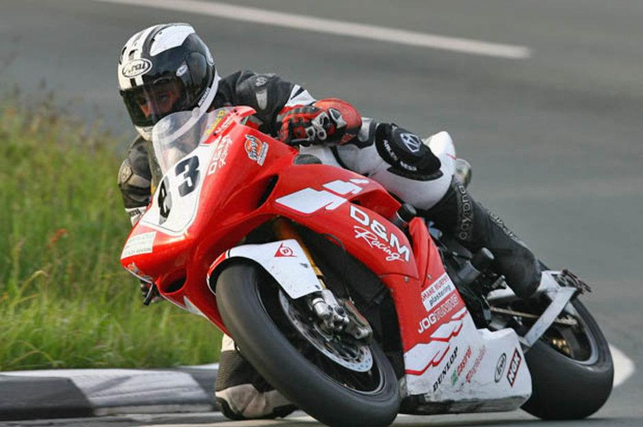 Isle of Man TT: Michael Dunlop races to victory after Ian Hutchinson rushed to hospital