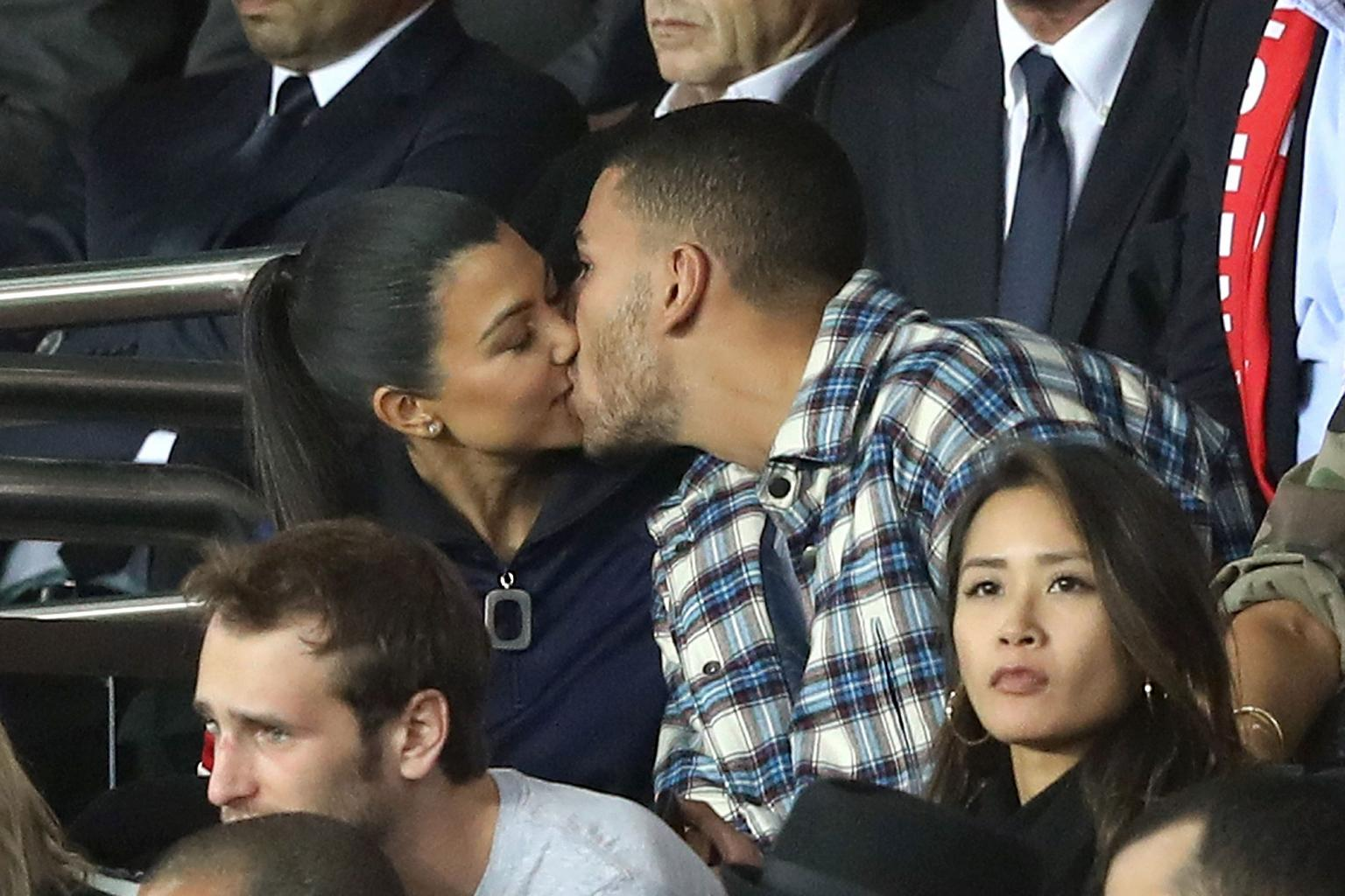 Kourtney Kardashian and Boyfriend Younes Bendjima Share Steamy Kiss at Paris Soccer Game — But He Appears Distracted