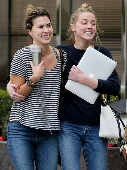 Amber Heard Smiles and Gets Support from a Friend in First Public Outing Since Court Appearance Over Johnny Depp Abuse Allegations