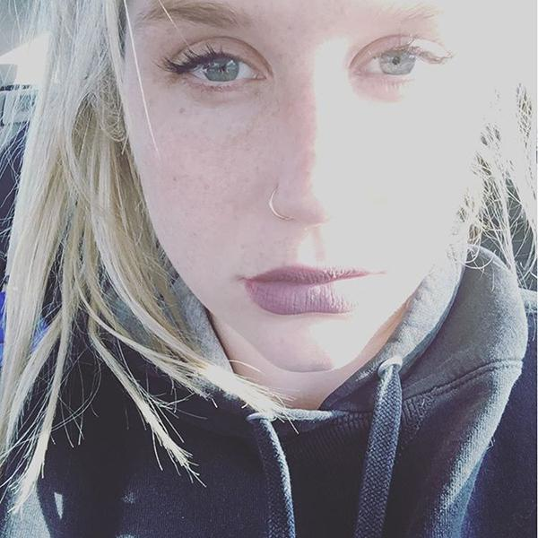 Kesha Puts Pen to Paper Amid Dr. Luke Legal Battle: 'I've Be