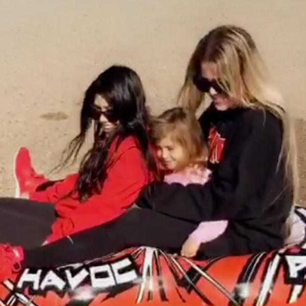Khloe Kardashian, Kourtney Kardashian and Penelope Disick Play in the Snow in Los Angeles on Christmas Eve