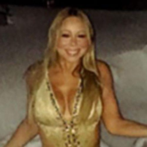 Mariah Carey Channels Glitter in Gold Swimsuit