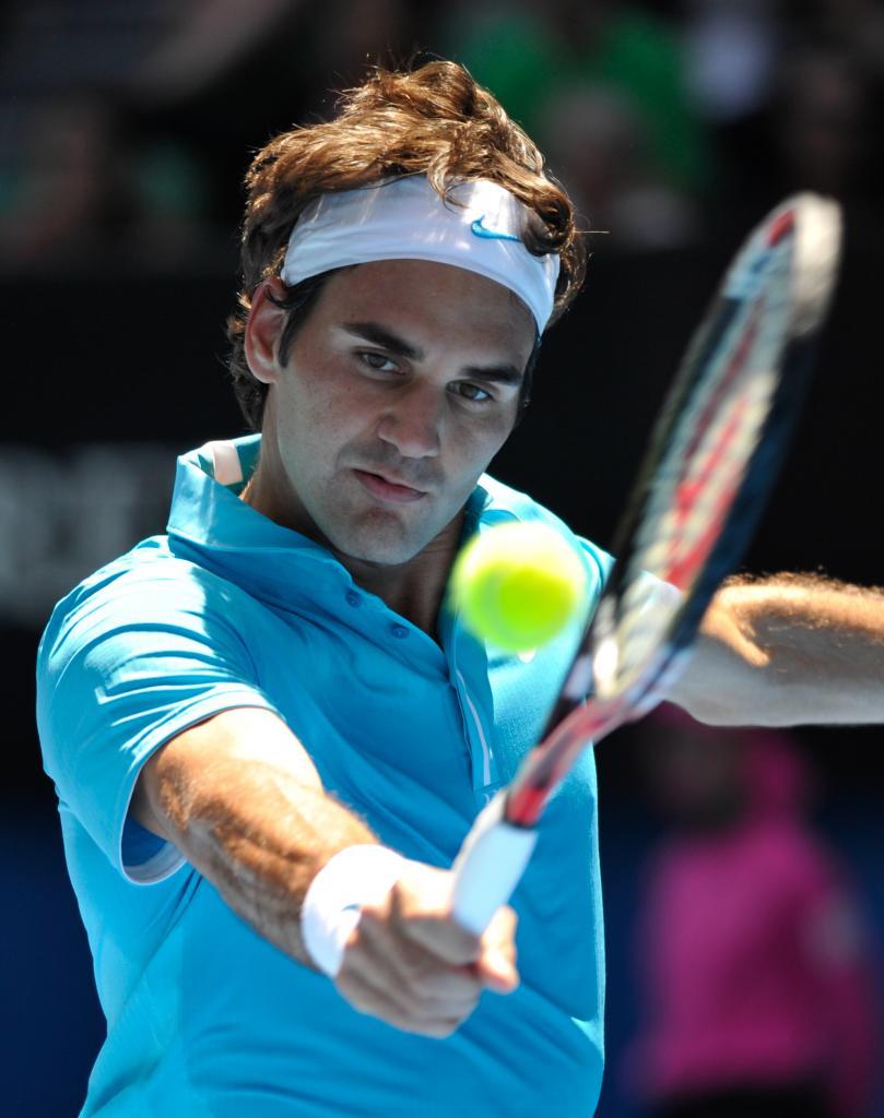 Australian Open Federer keeps his cool as heat of battle is fierce around him Kevin Mitchell