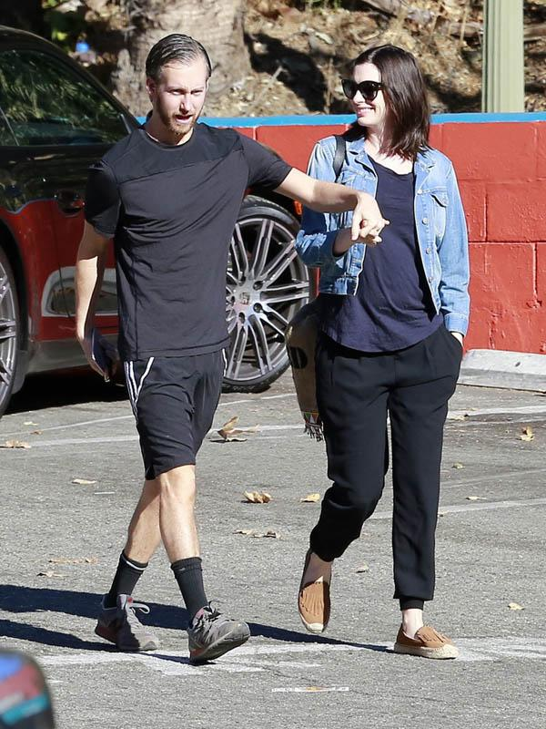 Anne Hathaway Smiles As She Steps Out With Husband Adam Shulman