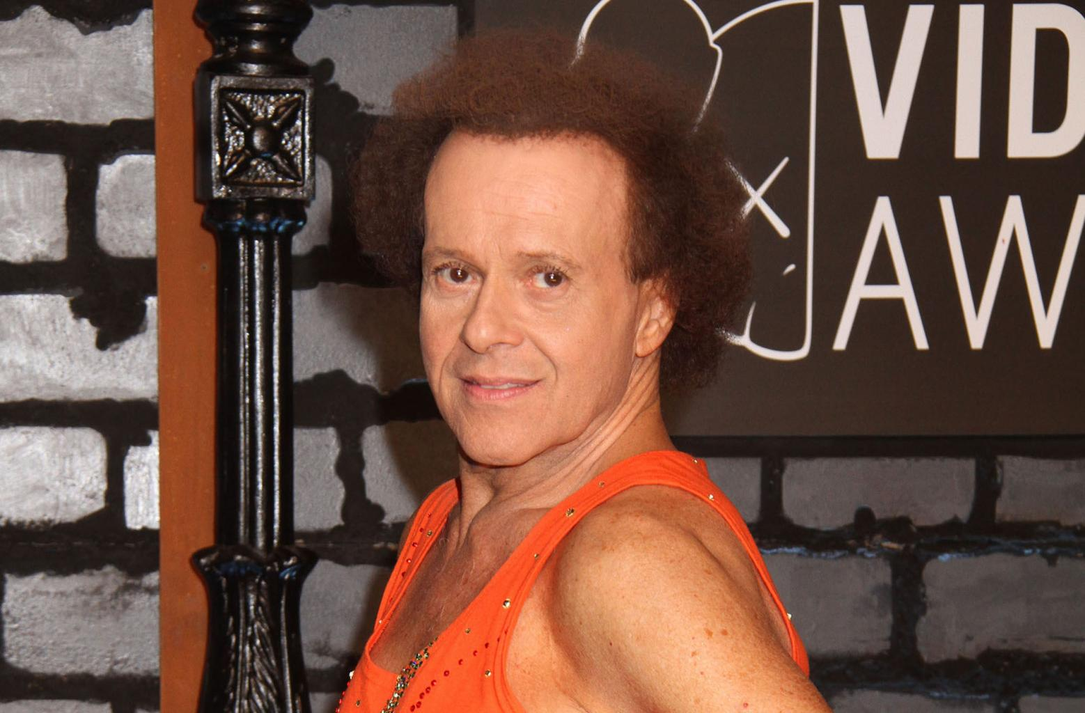 Richard Simmons      '  Reclusiveness Due To Knee Injury, Claims Friend, Insists He       's        Perfect