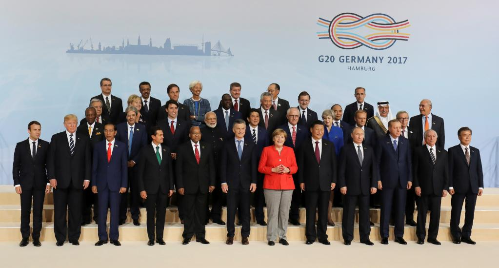 Unable to shove his way into prime position, Trump was left on the outside looking in for his first G20 group photo