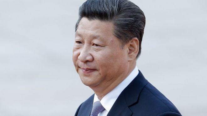 May meets Xi Jinping as China suggests 'shelving' Hong Kong row