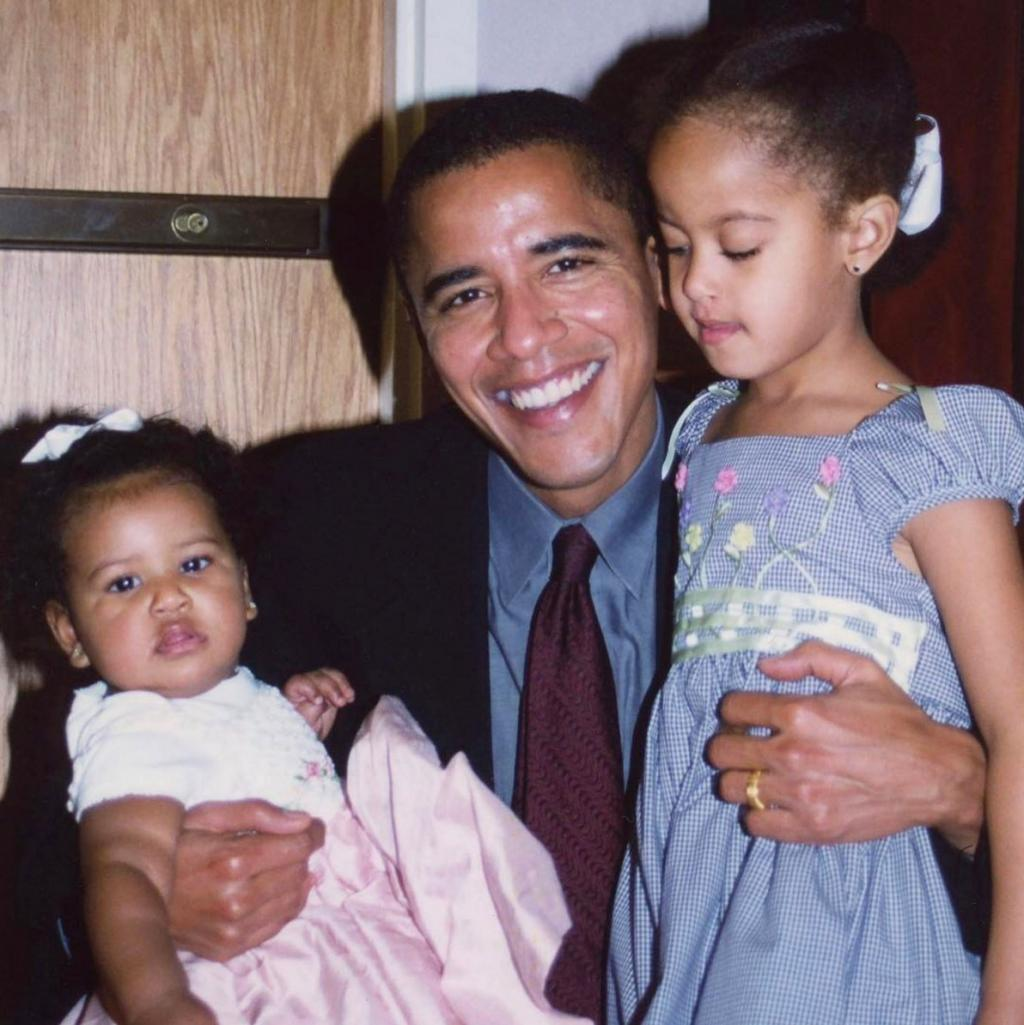 We Love You       ': Michelle Obama Shares Vintage Image of Barack and Daughters on Father        s    Day