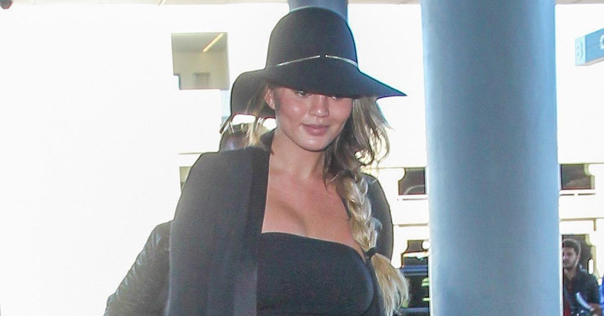 A Smiley Chrissy Teigen Catches a Flight in La Just Days Aft
