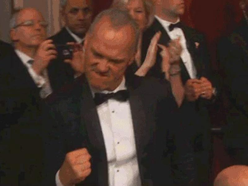 A Very Excited Michael Keaton Fist Pumps His Way to Stage Af