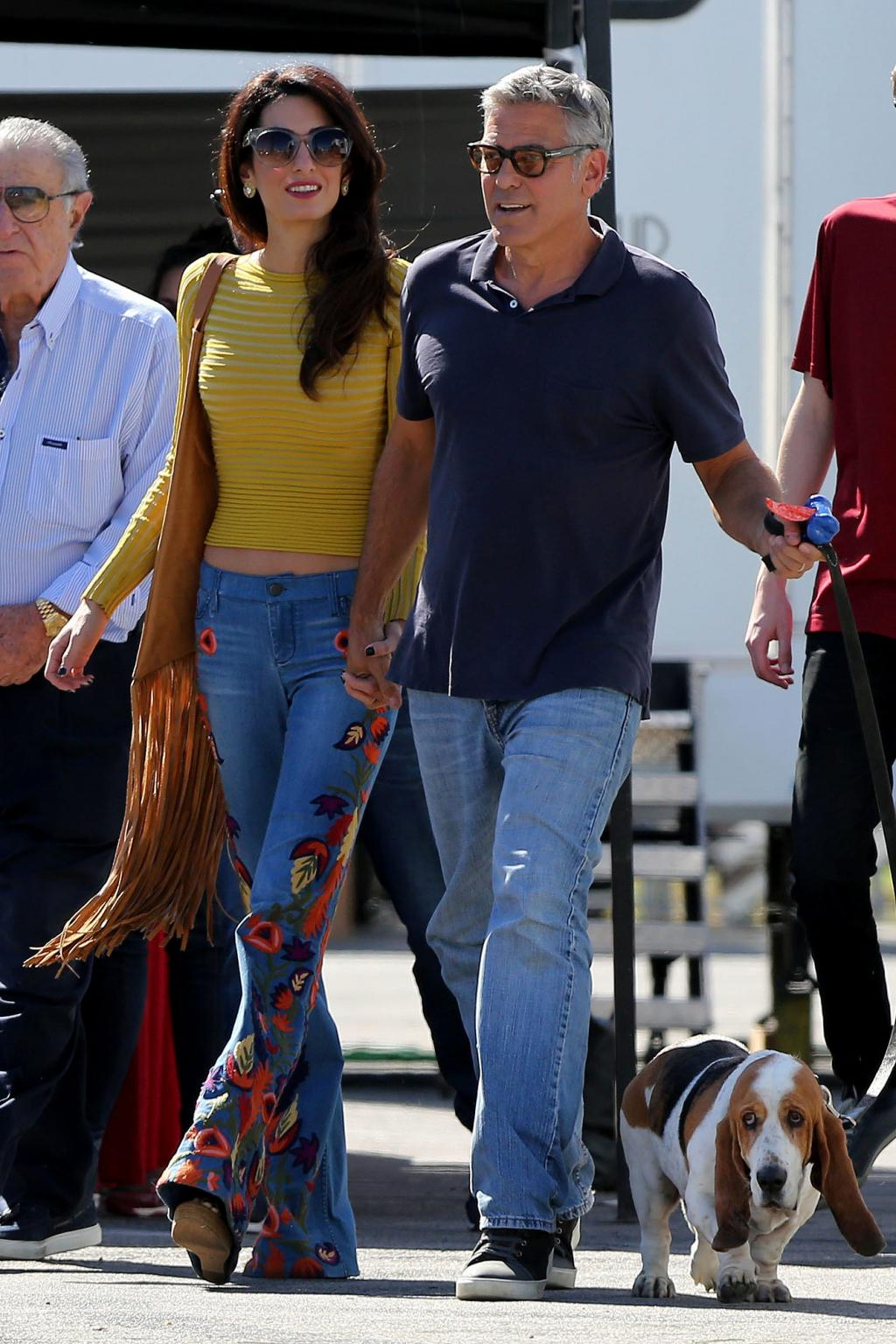Amal Clooney Is         70s Fall Chic in Alice + Olivia Embroidered Jeans on Set of Husband George       's Movie Set