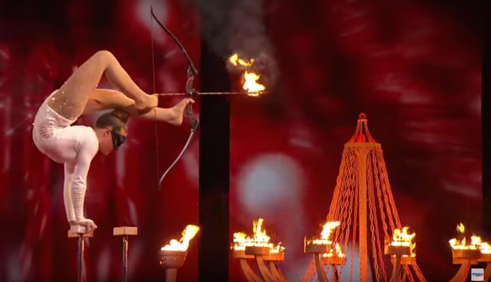 America's Got Talent  Contestant Shoots Flaming Arrow With Feet While Blindfolded!