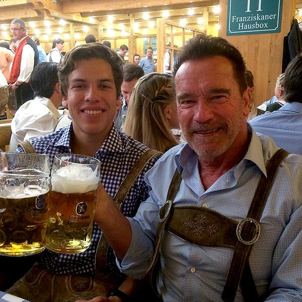 Arnold Schwarzenegger and Joseph Baena Take a Father-Son Trip to Oktoberfest