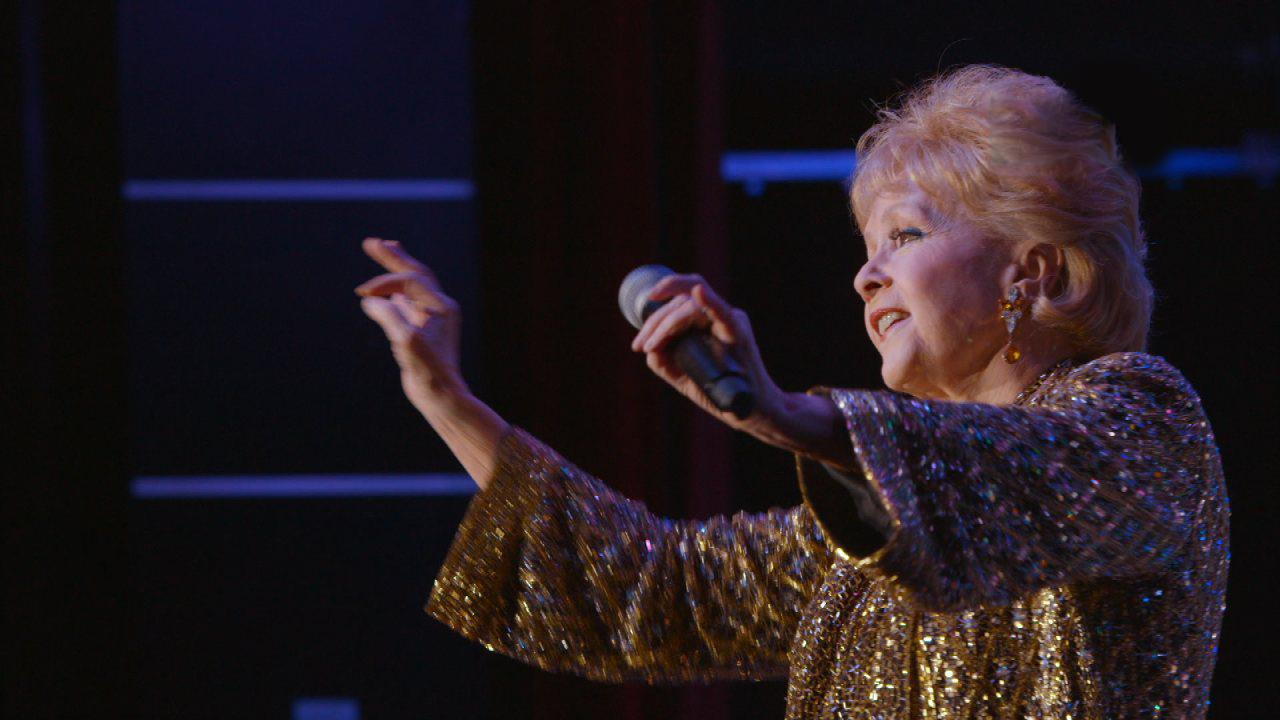 Exclusive: Debbie Reynolds Charms the Crowd in One of Her Final Shows – Watch the 'Bright Lights' Sneak Peek!