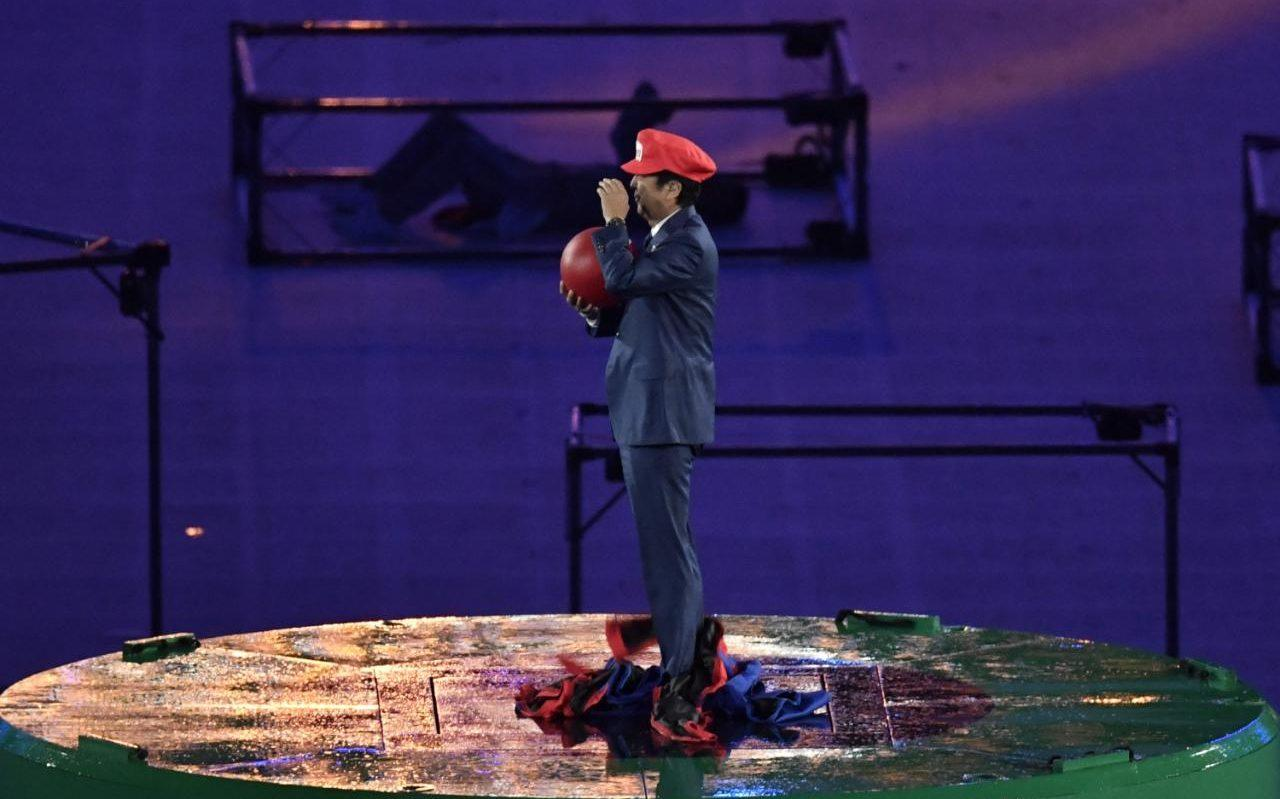 Japanese PM Shinzo Abe emerges from a green pipe disguised as Super Mario during Rio Closing Ceremony