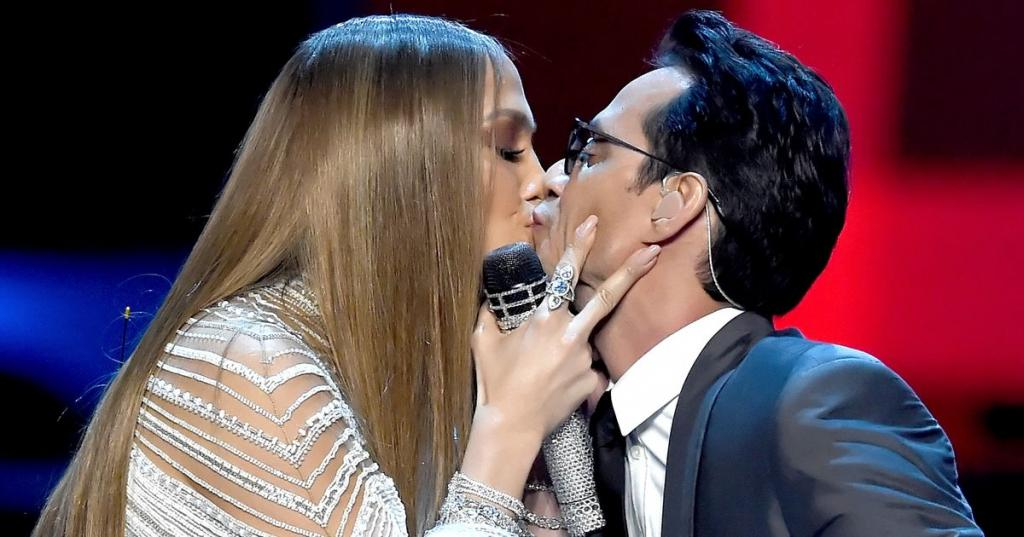 Jennifer Lopez and ex-husband Marc Anthony share a kiss at the Latin Grammys