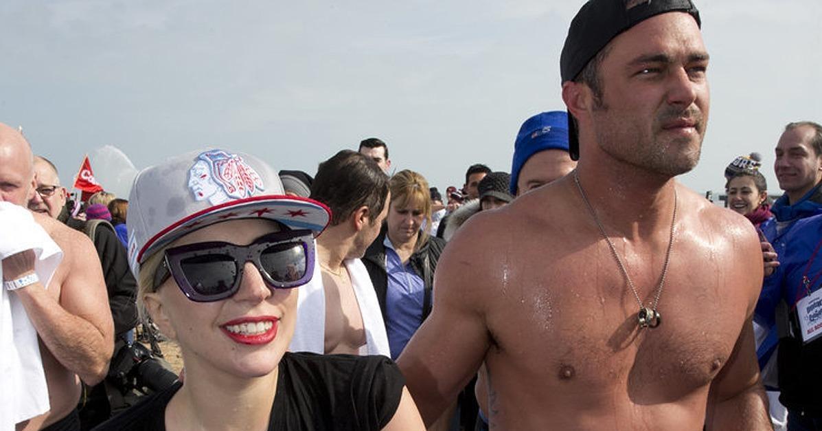 Lady Gaga and a Shirtless Taylor Kinney Jump Into Frigid Lak