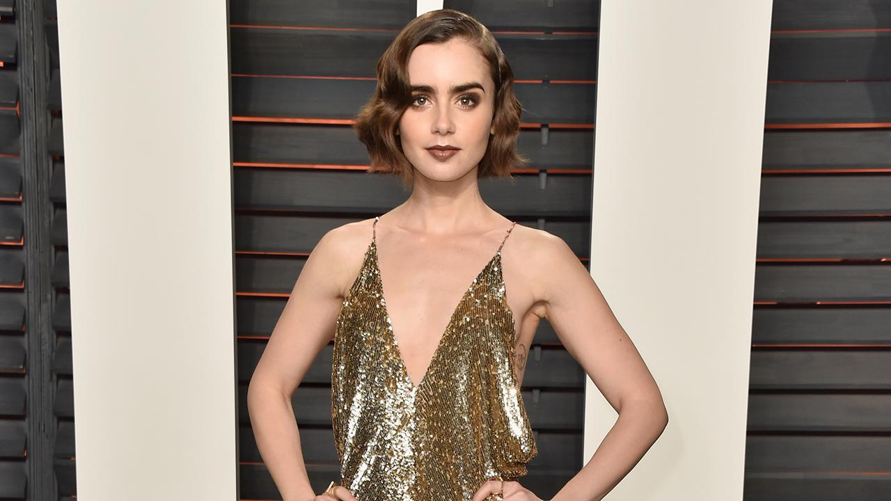 Lily Collins Strips Down to Find Perfect Gown for the Golden Globes -- See the Pic!