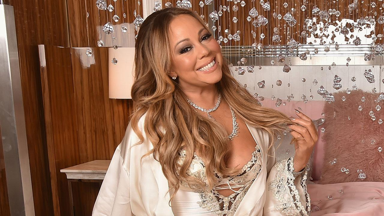Mariah Carey Strips Down to Bra While 'Festivating' By a Christmas Tree