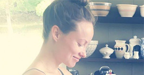 Olivia Wilde Shows Bare Baby Bump in a Bikini While Cooking
