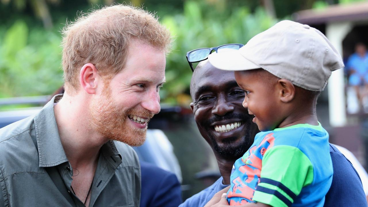 Prince Harry Meets With Children During Caribbean Visit -- See the Adorable Pics!