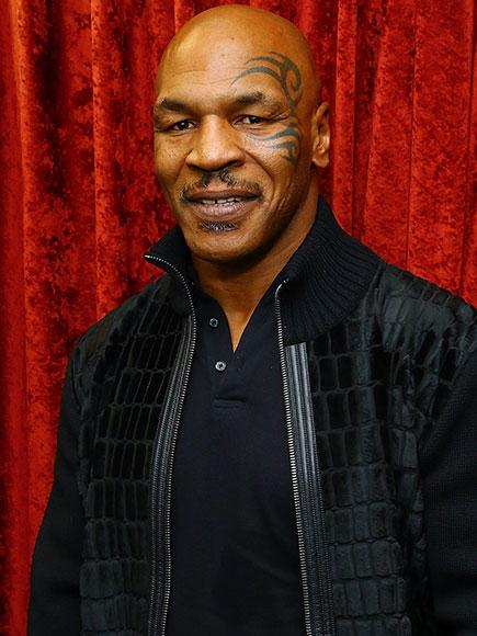 See Mike Tyson's Hilarious Hoverboard Fail: 'I'm Too Old For