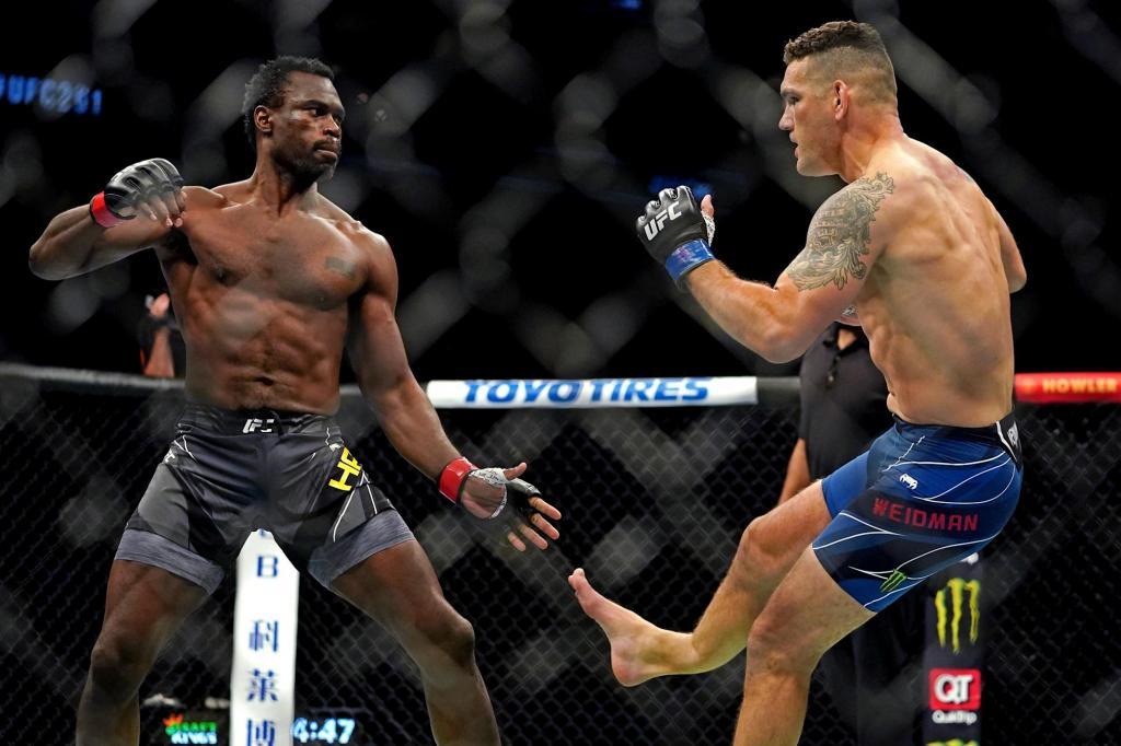 UFC 261 Chris Weidman snaps leg throwing kick vs Uriah Hall same way he beat Anderson Silva - Video