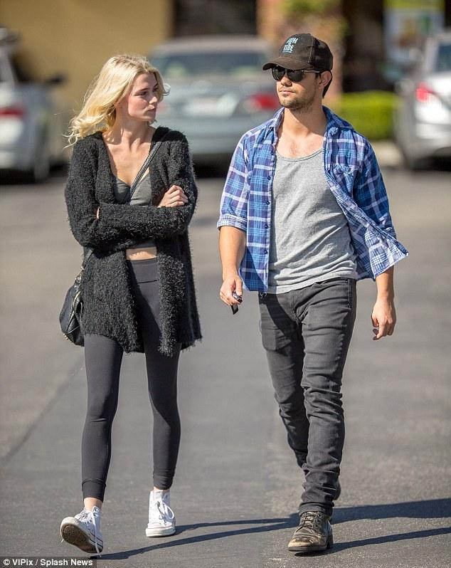 long! Taylor Lautner steps out with new model girlfriend Raina Lawson