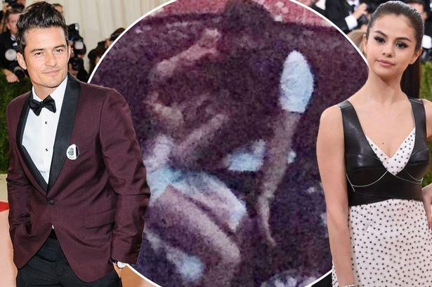 Selena Gomez and Orlando Bloom pictured all over each other in smoking