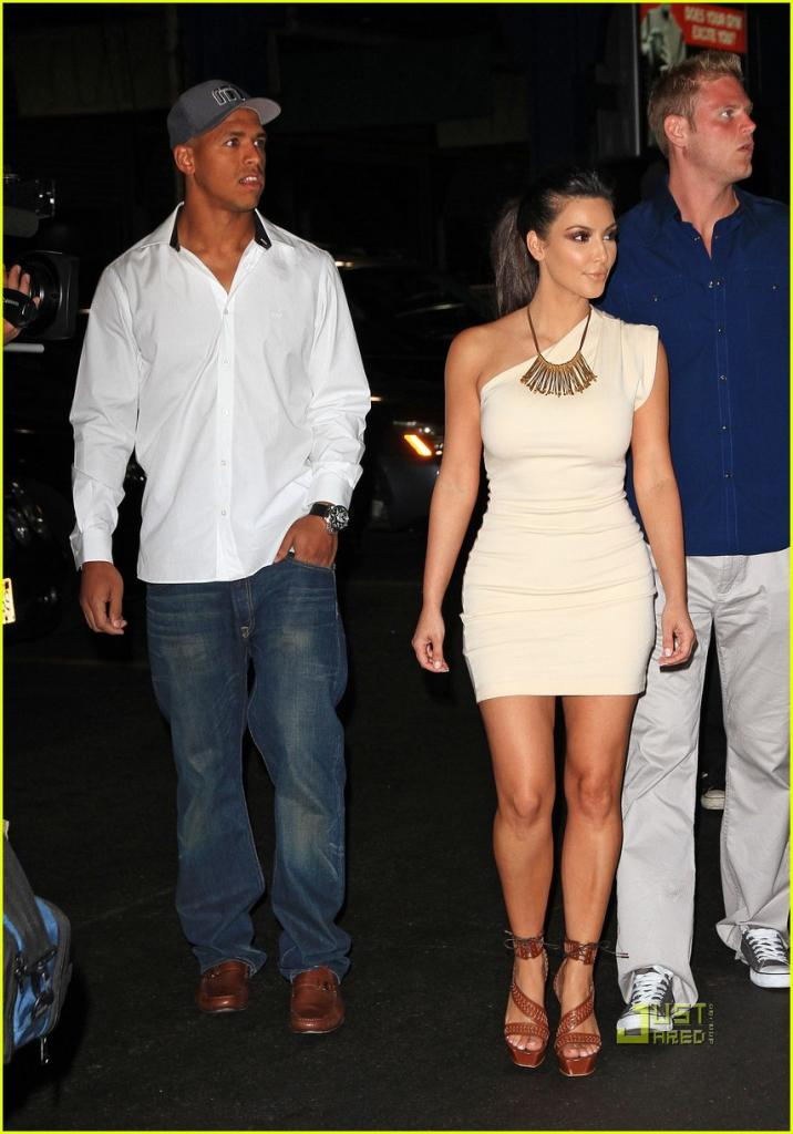 Kim Kardashian and Miles Austin take a walk to a yacht to celebrate