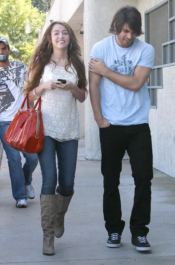 Miley Cyrus and Justin Gaston Photos Photos - Miley Cyrus And Justin