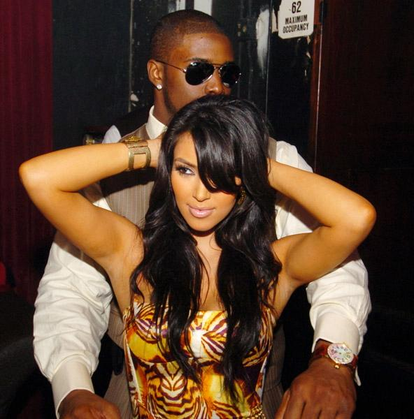 Kim Kardashian and Reggie Bush kissing and grinding