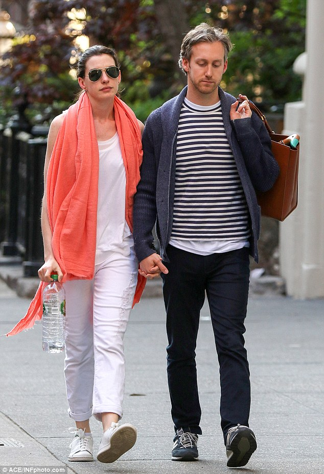 Anne Hathaway Wraps Up In A Coral Pashmina With Adam Shulman In NY