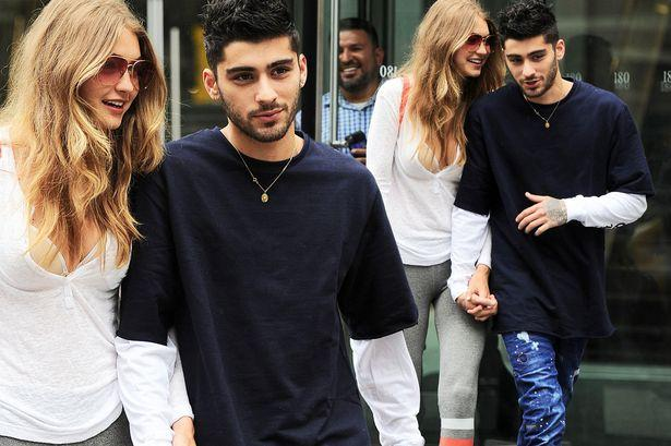 Besotted Gigi Hadid And Zayn Malik Can't Wipe The Smiles Off Their