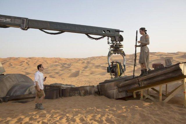 J.J. Abrams and Daisy Ridley in Star Wars: The Force Awakens
