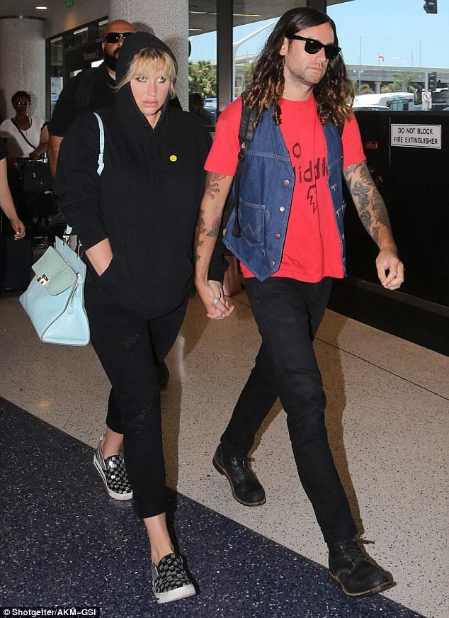 Kesha Keeps A Low-profile She Departs LAX With Boyfriend Brad
