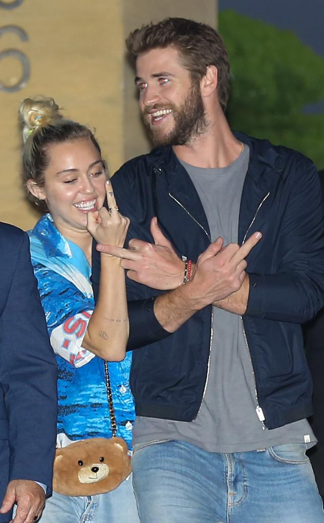 Miley Cyrus & Liam Hemsworth Are All Smiles As They Make Obscene