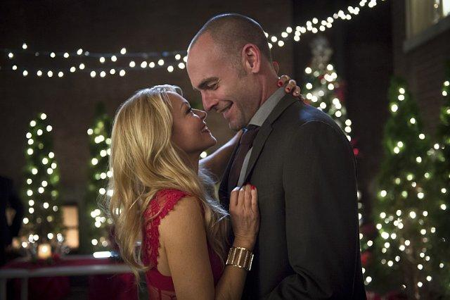 Still of Charlotte Ross and Paul Blackthorne in Arrow (2012)