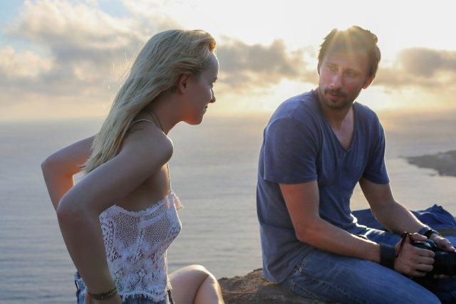 Still of Dakota Johnson and Matthias Schoenaerts in A Bigger