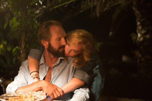 Still of Ralph Fiennes and Dakota Johnson in A Bigger Splash