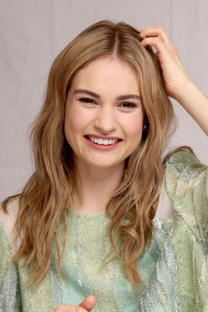 LILY JAMES at Cinderella Press Conference in Beverly Hills